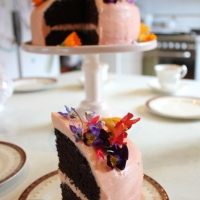 Rich chocolate cake and edible flowers