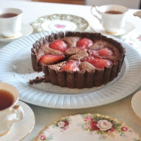 Chocolate tart with raspberry poached pear